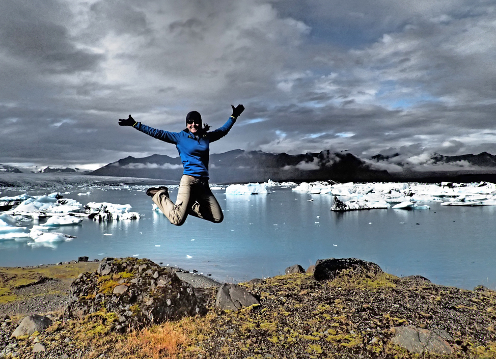 Young girl jumping by the Glacier Lagoon