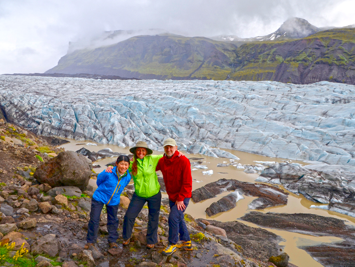 People standing by glacier Svínafellsjökull in Vatnajökull national park